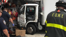 Truck Smashes Into Store, Barely Missing Pedestrians:  Video