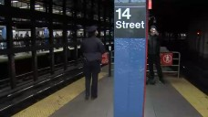 Woman Rescued After She's Pushed Onto Subway Tracks: Sources