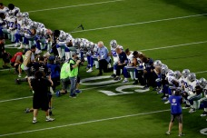 Cowboys Kneel as a Team Prior to National Anthem in Arizona