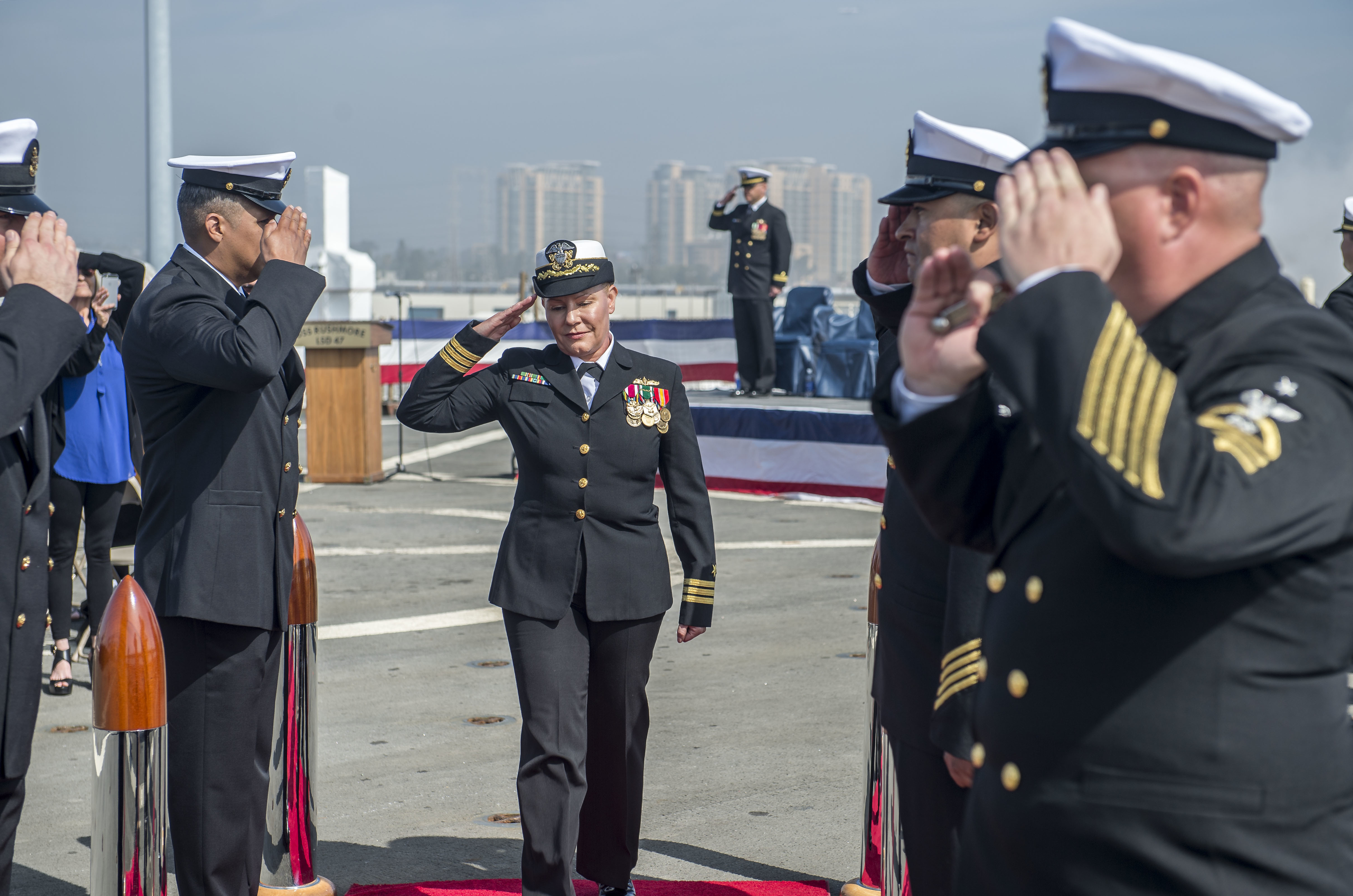 SAN DIEGO (Mar. 1, 2016) – Cmdr. Sarah H. De Groot, commanding officer of the amphibious dock landing ship USS Rushmore (LSD 47), salutes side boys during a change of command ceremony. (U.S. Navy photo by Mass Communication Specialist 3rd Class Gerald Dudley Reynolds/Released)