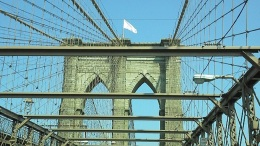 Bleached-White American Flags Appear Atop Brooklyn Bridge