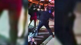 Raw Video: Police Officer Appears to Punch Woman