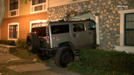 Hummer Rammed Through Hotel Wall in Family Dispute