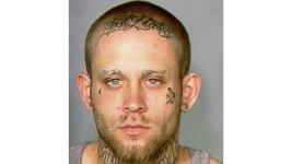 Judge Orders Defendant to Cover Swastika Tattoos