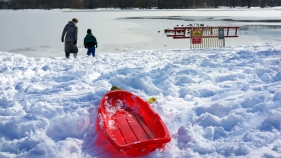 Kids and Adults Head to Parks for Snow Fun