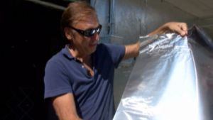 Artist Covers Every Inch of Home in Aluminum Foil