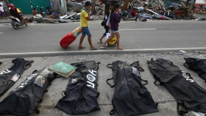 Typhoon Death Tolls Rises as Gov't Defends Response