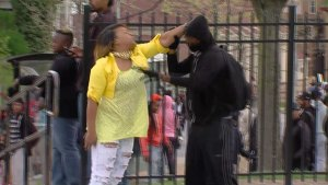 WATCH: Woman Pulls Boy From Baltimore Riot