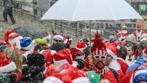 Hundreds of Santas Hit NYC Streets for SantaCon Despite Snow