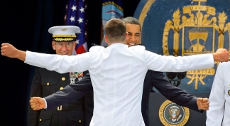 Obama Embraced at Annapolis Ceremony