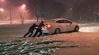 Snow Traps Cars on Roads, Shuts Down Highways