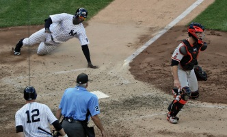 Yanks Topped by Giants in 12 Innings