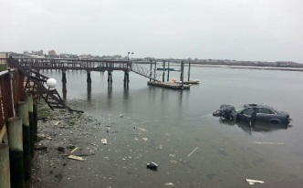 Men Rescued After Car Hits Pole, Plunges Into Water: Police