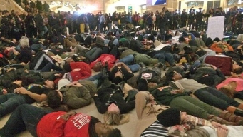 Garner Decision Protesters Flood Grand Central, Macy's