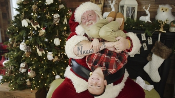 Santa With 'Naughty' and 'Nice' Tattoos Must Tone it Down