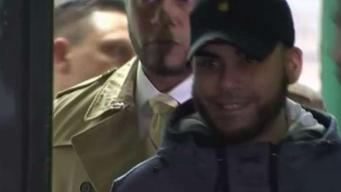 Dad Accused in Baby Son's Death Smirks as Cops Lead Him Out