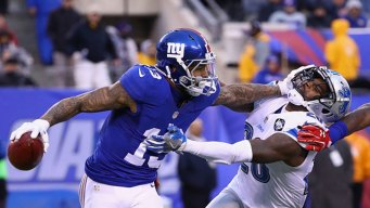 Manning's 2 TDs, Beckham One-Hander Lead Giants Past Lions