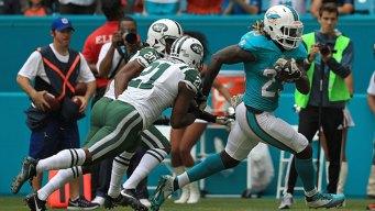 Miami Dolphins Narrowly Beat Jets in 27-23 Win