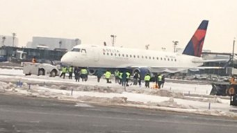Plane Gets Stuck in Snow at LaGuardia