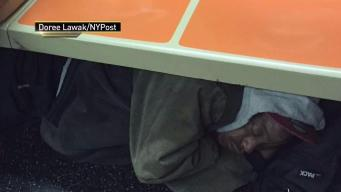 Man Sleeping Under Subway Seats Sparks Controversy