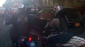 Charges Stand in SUV-Biker Melee: DA