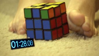 Whiz Kid Bored With Rubik's Cube Solves Puzzle With His Feet