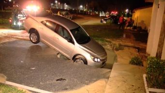 Hole Caused by Burst Pipe Swallows Car and Driver