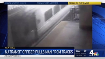 Cop Drags Man from Tracks Seconds before Train Arrives