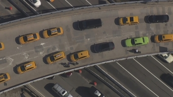 Passengers Snarled in Traffic Get Out of Cars to Walk to LGA