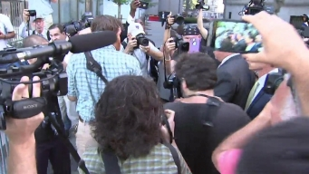 Weiner Mobbed by Press as He Arrives at Court