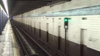 Woman Pushed Onto Subway Tracks in Unprovoked Attack: Police