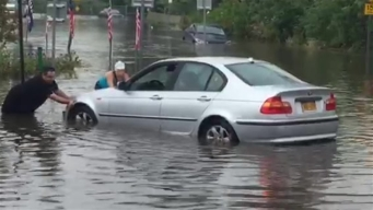 Cars Stuck in Water as Strong Storms Flood Huntington