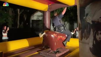 Wild Video Shows Cop Ride Mechanical Bull With Gun at Hip