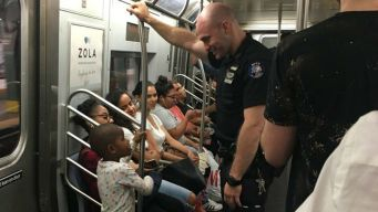 Cop, Kid Share Sweet Moment on Subway