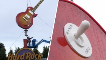 Got 'Rhythem'? NJ Hard Rock Butchers Spelling on Giant Guitar