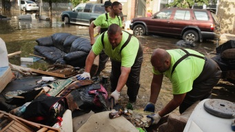 As Water Recedes, Cleanup Begins
