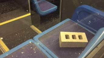 Brick Flies Through Roof of MTA Bus