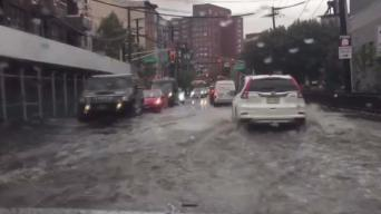 Cars Slog Through Floods in Hoboken