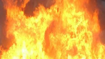 Officer, Good Samaritan Rescue Woman From Burning Home