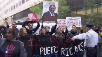 Museum of Modern Art Reopens Amid Protests Outside