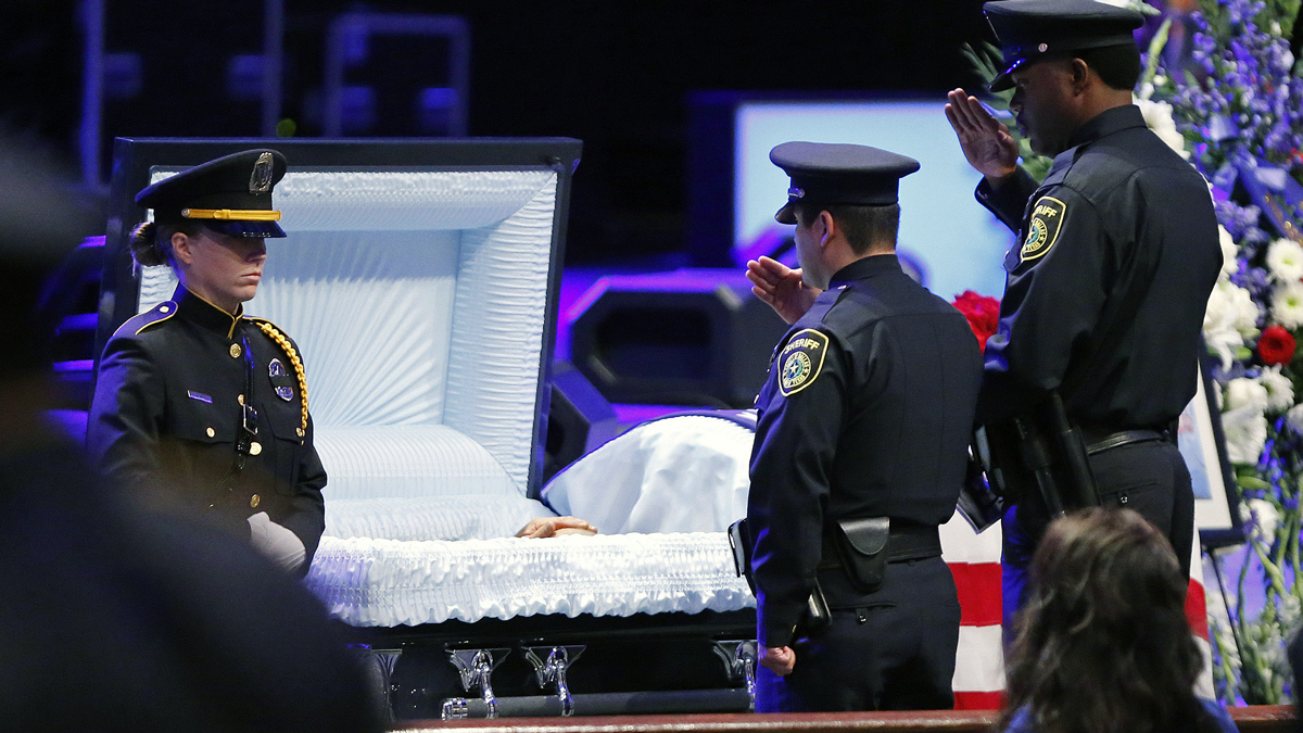 Law enforcement agents pay respects during a viewing before the funeral service for Senior Corporal Lorne Ahrens at Prestonwood Baptist Church on July 13, 2016, in Plano, Texas. Ahrens was one of five Dallas police officers shot and killed by a sniper during a Black Lives Matter march in Dallas. (Photo by Stewart  F. House/Getty Images)