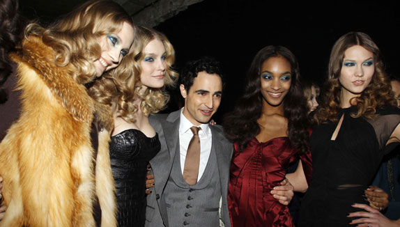 Backstage Shot: Zac Posen with a Bevy of Models