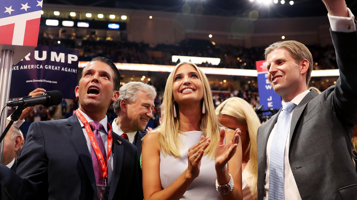 Donald Trump Jr. (left) along with Ivanka Trump (center) and Eric Trump (right), take part in the roll call in support of Republican presidential nominee Donald Trump on the second day of the Republican National Convention on July 19, 2016, at the Quicken Loans Arena in Cleveland, Ohio.