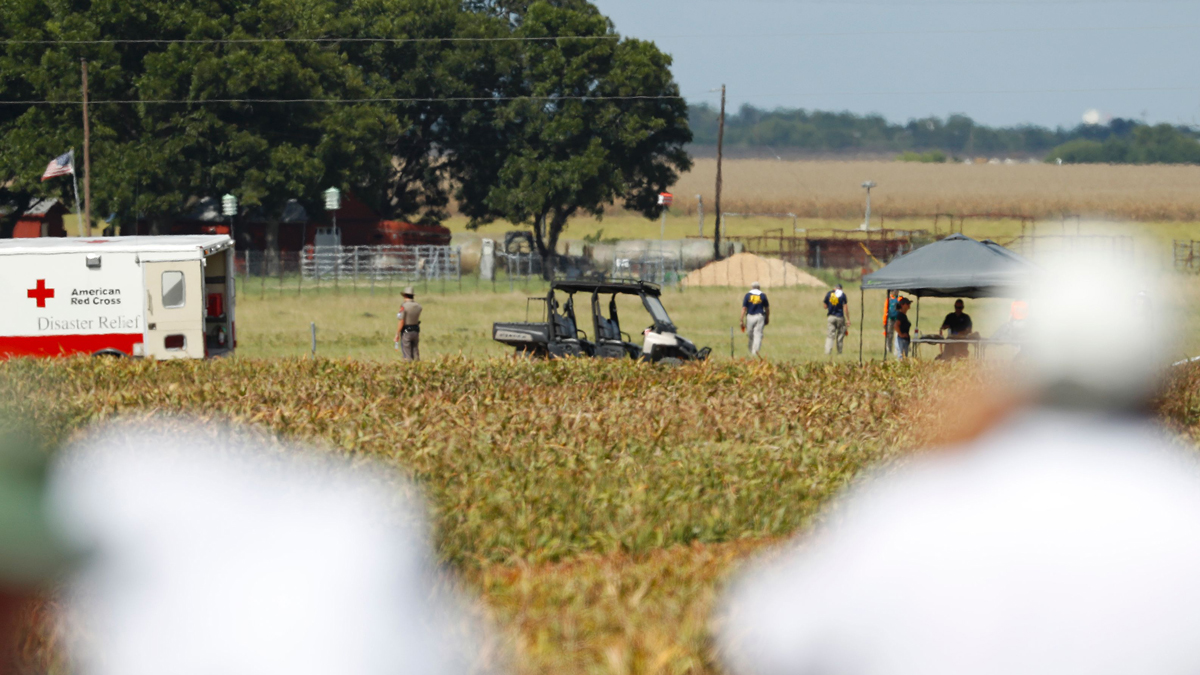 Authorities investigate the site of a hot air balloon crash in central Texas on Saturday, July 30, 2016. At least 16 people were killed.
