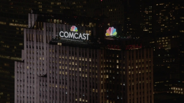 [NY] 30 Rock Lights Up With New Comcast Name, NBC Peacock