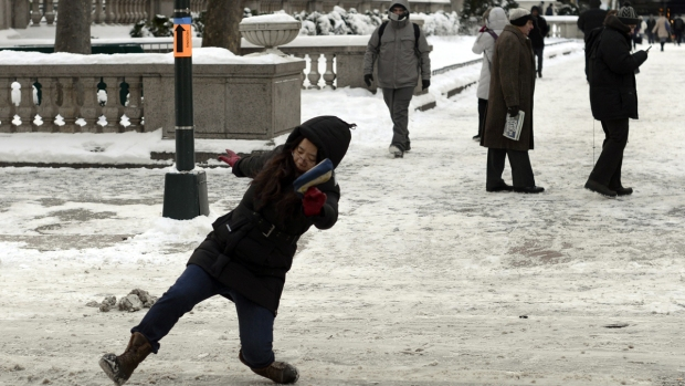 PHOTOS: Slips, Falls on Icy Streets After Snowstorm