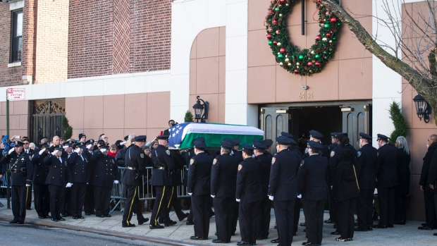 [NY] Fellow Cops Salute Murdered NYPD Officer's Flag-Draped Casket