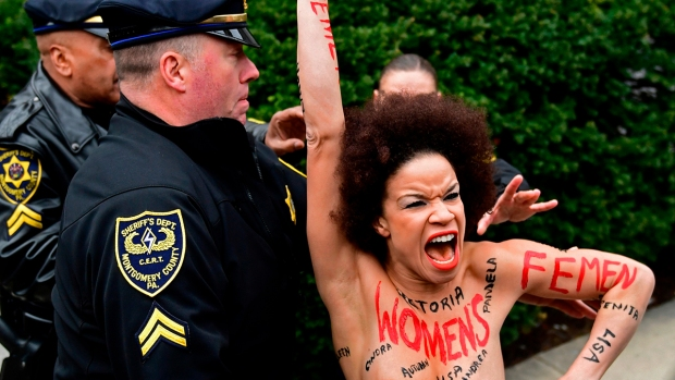 [NY] Topless Protester Charges at Bill Cosby