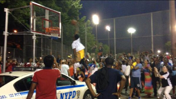 [NY] Staten Islander Slam-Dunks Basketball Over NYPD Car