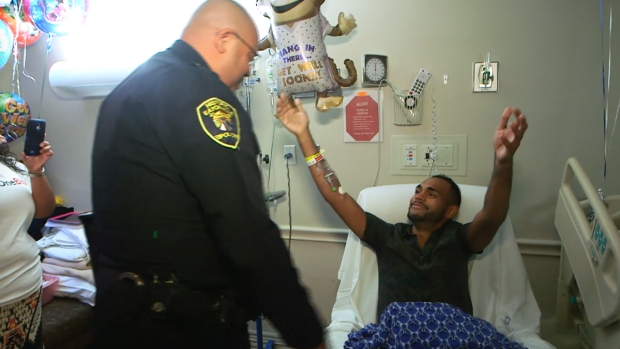 Orlando Survivor Reunited With Cop Who Helped Save His Life